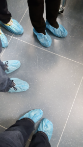 Paper shoes in clean room, NASA Houston